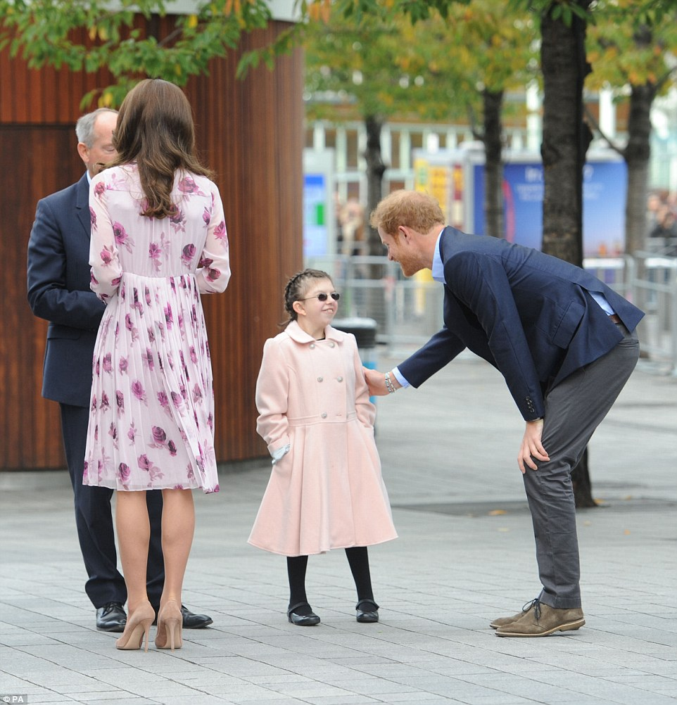 Caring Prince Harry engages with Joanne Sibley as they chat outside London's County Hall