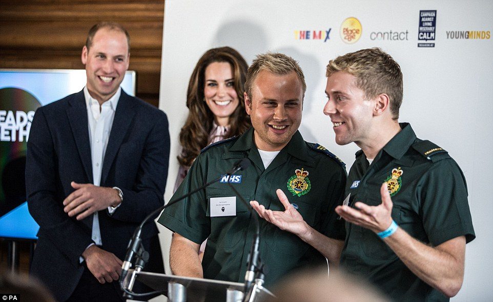 The Duke and Duchess of Cambridge listen to ambulance men Dan Farnworth and Rich Morton speak of how they helped each other cope with traumatic situations