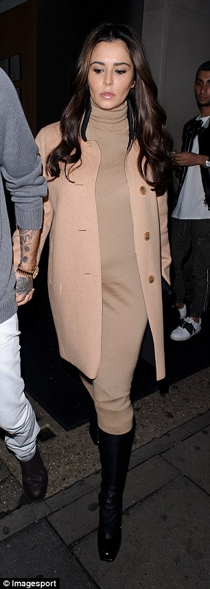 Covered up: Cheryl wore a matching coat and jumper dress