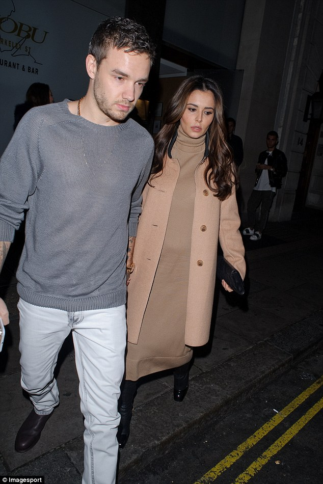 Keeping her close: It's believed that Liam only arrived back in the UK that morning