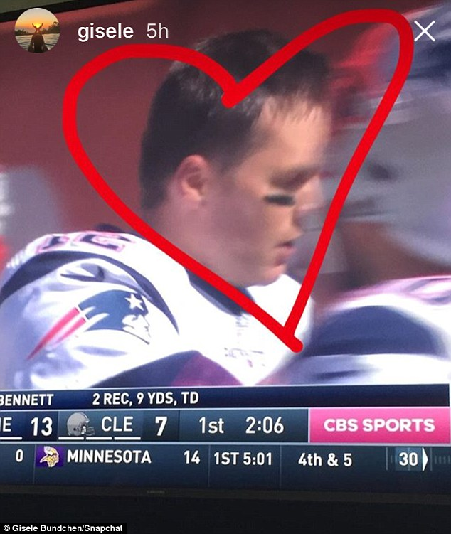 So proud: Gisele drew a heart around her man for a Snapchat post while watching him play