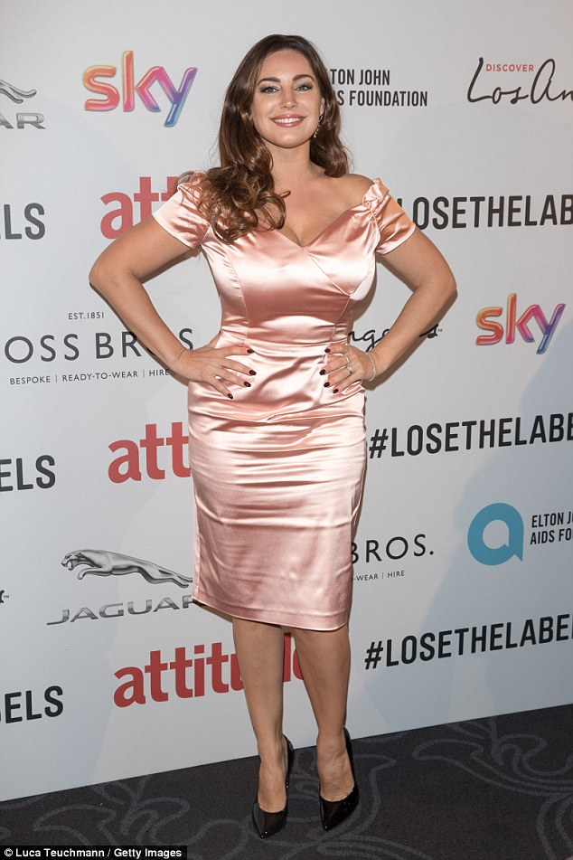 Glam:Kelly chose a pink satin number for the awards do, showing off her voluptuous curves to the max