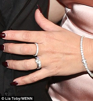 New bling:The star was still flaunting the diamond band on her wedding finger