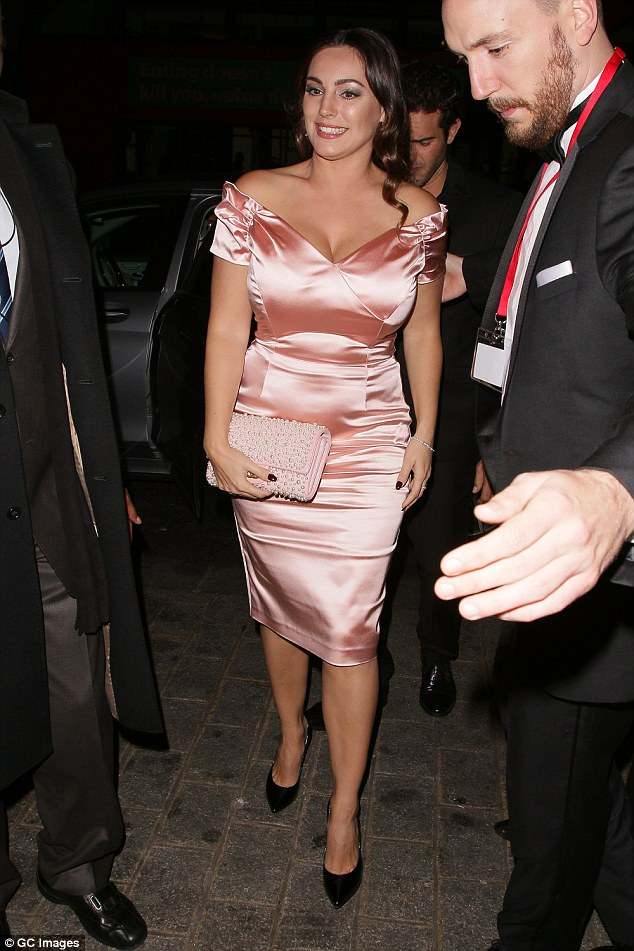 Celeb coming through: The glam star was ushered through the crowd by security
