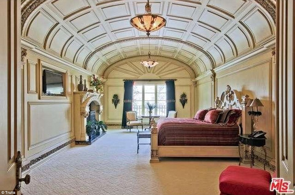 Above, a view of one of the 15 bedrooms in the Atlanta, Georgia home, currently for sale at nearly $19million