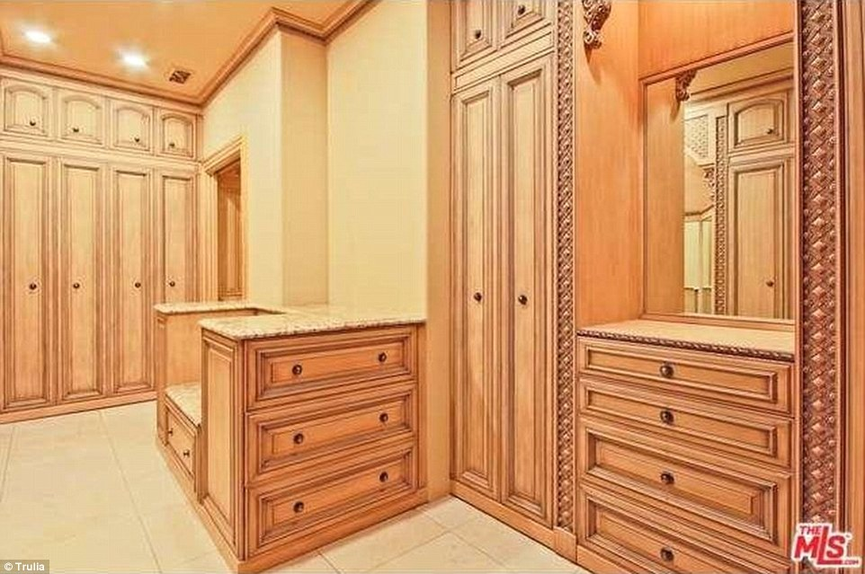 Above, a view of one of the home's walk-in closets fit for a king or queen