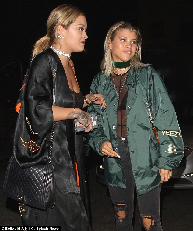 Blonde pals:After enjoying dinner Rita was spotted meeting up with Sophia, 18, who looked casual in black ripped jeans and a large khaki Yeezy bomber by Kanye West