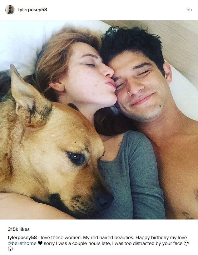 Cuddles: Posey on Sunday shared a bedside shot with the actress and his dog Roxy