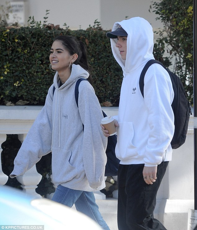 Good pals: The 16-year-olds kept the autumn chill at bay with matching hoodies as they grabbed a coffee and wandered through North London
