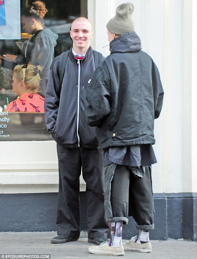 Earlier on: Rocco was spotted laughing as he chats to a friend in Primrose hill