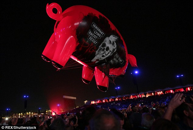 Meanwhile, in keeping with the pig-themed attacks on Trump, a parade-sized balloon shaped like a pig floated above the audience of 75,000 people