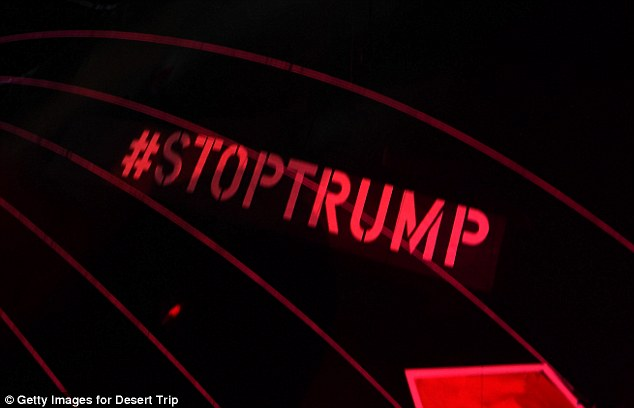 A hashtag on the underside of the pig float read '#STOPTRUMP' as it floated over the crowd