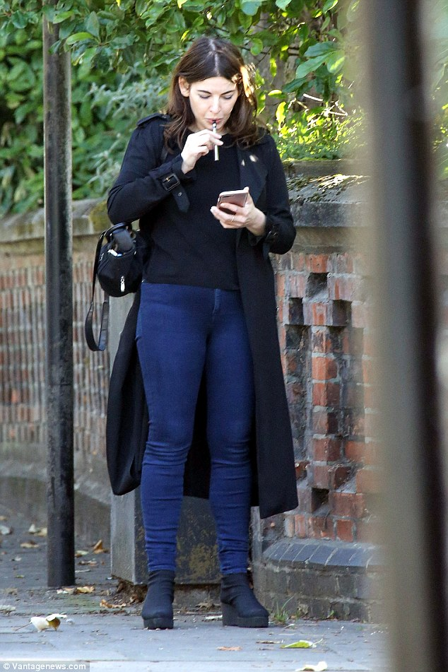 Smokin': Nigella Lawson enjoyed a well-deserved day off as she displayed her off duty fashion while smoking on an E-cigarette in London on Monday