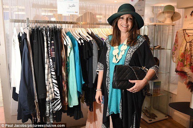 Dame Joan Collins has donated more than 150 items from her wardrobe to the Shooting Star Chase charity shop in Guildford (pictured Sue Hamblett assistant manager of the shop wears an £80 green patterned kaftan, a £30 white stone necklace, a £150  Patricia Underwood hat and a Chanel bag with a reserve price of £500)
