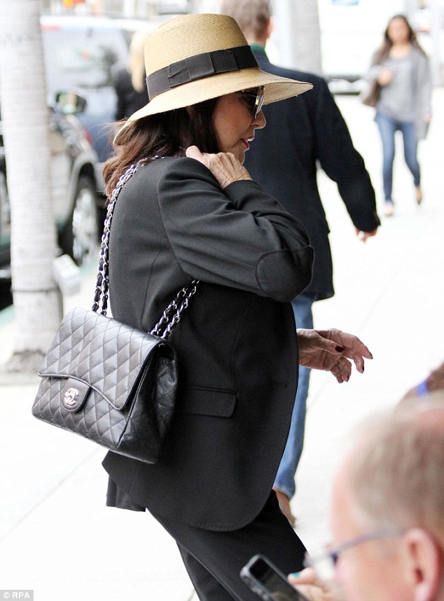 Ms Collins was pictured wearing the iconic quilted bag while stepping out in Los Angeles in March 2013
