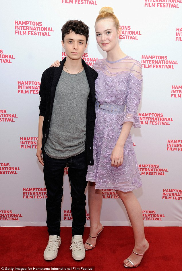Come here! Fanning was joined by 20th Century Women co-star Lucas Jade Zumann, who kept it casual in black trousers and a grey top