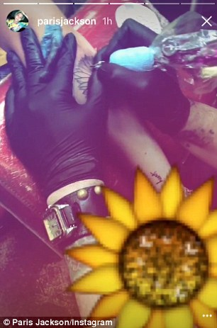 Ouch! The 18-year-old gave a close up look as tattoo artist Justin Lewis worked on the new design