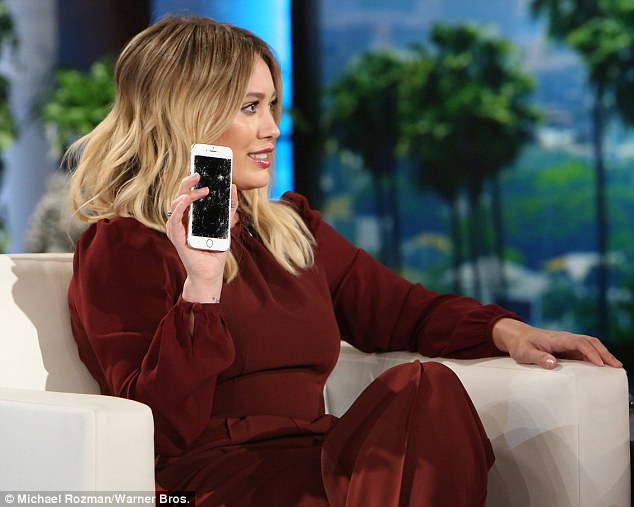 Cracked up: The actress showed her shattered cell phone screen