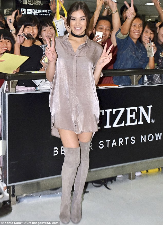 Looking V-ery nice: Hailee Steinfeld flashed peace signs and her thighs in Japan on Sunday