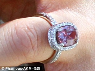 Simply stunning: The star's incredible sapphire engagement ring sparkled