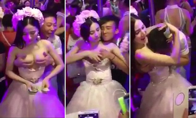 'Bride' who was filmed letting men grope her breasts is revealed to be a Thai transsexual