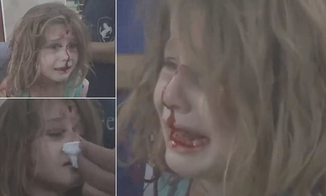Syrian girl cries for her father after she becomes latest victim of the civil war