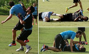 Luis Suarez dons goalkeeper gloves in training with Uruguay... but pays the price as he