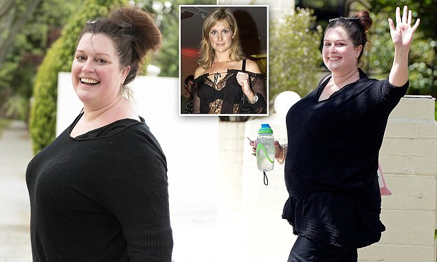 A barely recognisable Kate Fischer laughs and waves as she emerges from her Melbourne home