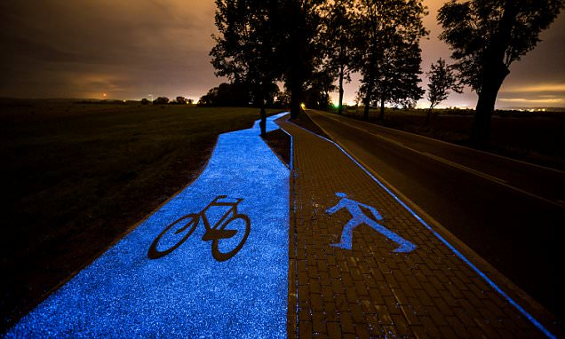 A wheely bright idea! The solar-powered bike lane that GLOWS blue in the dark