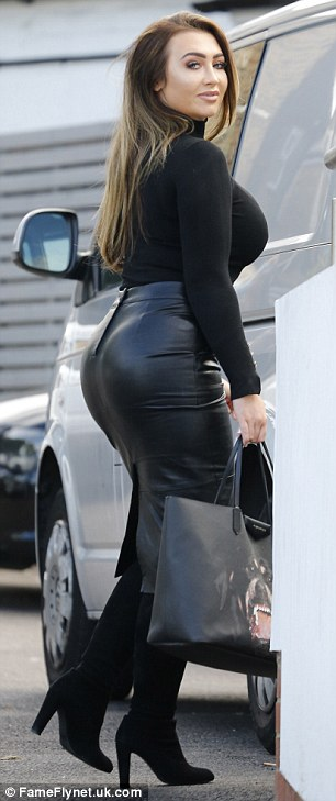 Don't mind me: But busty Lauren was hard to miss as she sauntered across an Essex car park
