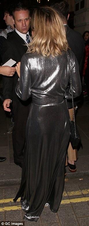 Here she comes: The stunning star was the centre of attention as she made her way into the venue in her dramatic dress