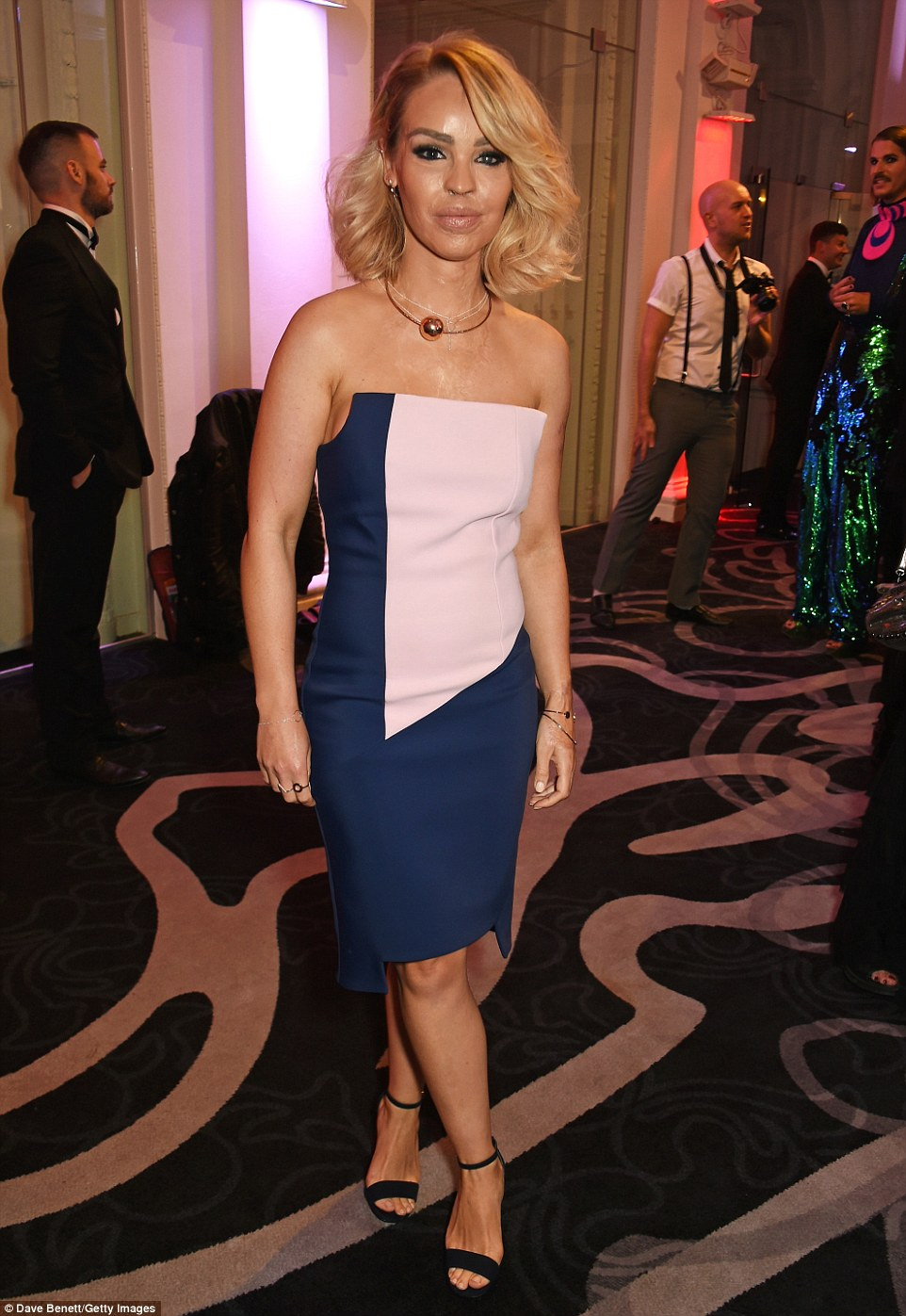 Chic: TV personality Katie Piper wowed in a structured blue and pink dress with a strapless top while she paired the look with a bold ball necklace and thin strap black heels. She was joined by her handsome husband James Sutton