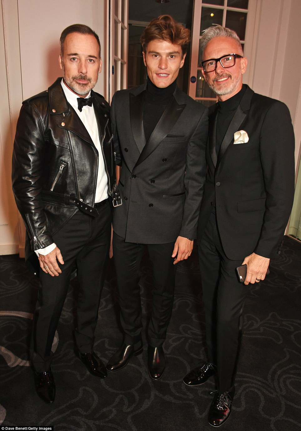 A great turnout: David (pictured with model Oliver Cheshire and Patrick) was in attendance to throw his support behind his husband Elton John's AIDs Foundation, of which the awards show was helping raise funds