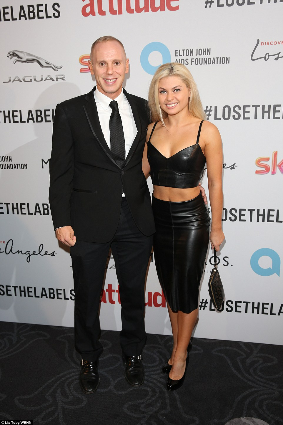 Dance with me: Strictly star Judge Rinder was spotted on the carpet with his professional dancing partner Oksana Platero, who wowed in a stunning black leather skirt and bralet combination which showed off every inch of her physique