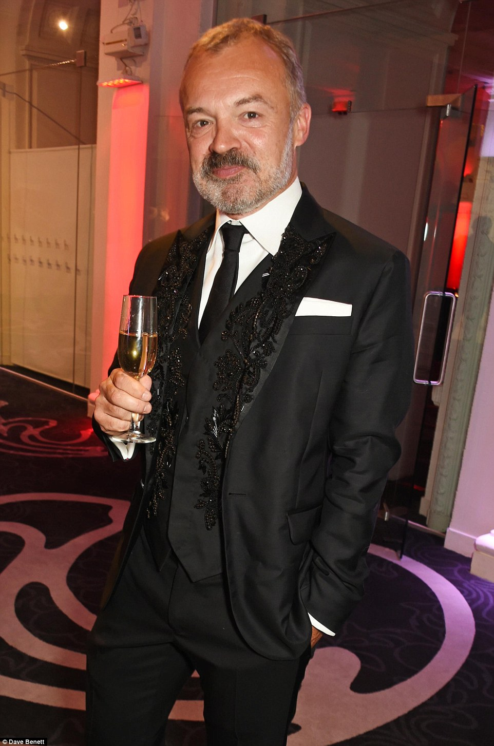Nothing to see here: Graham Norton was looking dazzling in a three piece suit adorned with beading across the breast and lapels