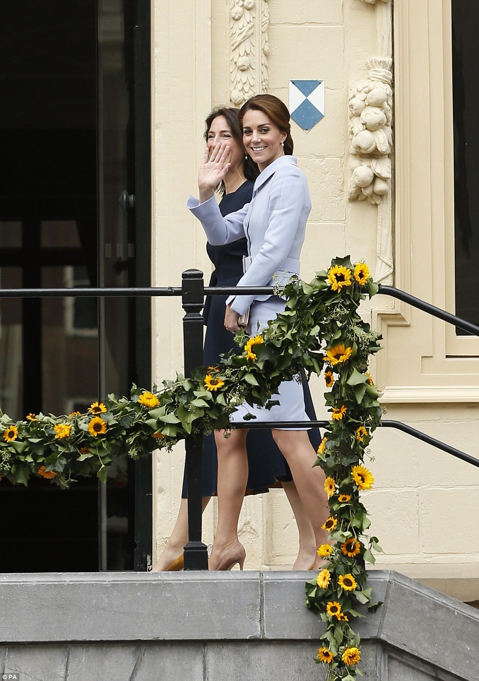 Kate waves to the crowd as she arrives at the Mauritshuis gallery in The Hague to visit an exhibition of 22 picture by Dutch artists loaned to the art gallery from the Royal Collection