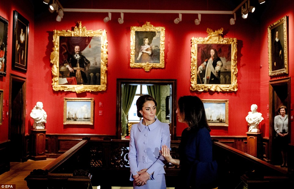 Kate listens with interest as she tours the Mauritshuiswith museum director Emilie E.S. Gordenker