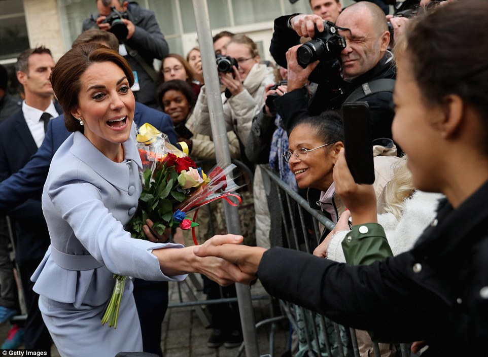 The Duchess seems determined to shake hands with as many people as possible as she arrives at Bouwkeet in Rotterdam