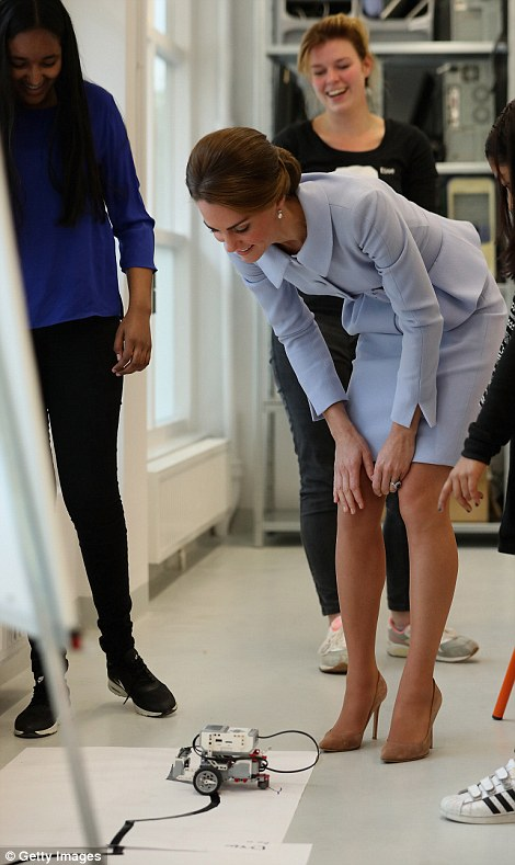 Kate bends down to get a better look