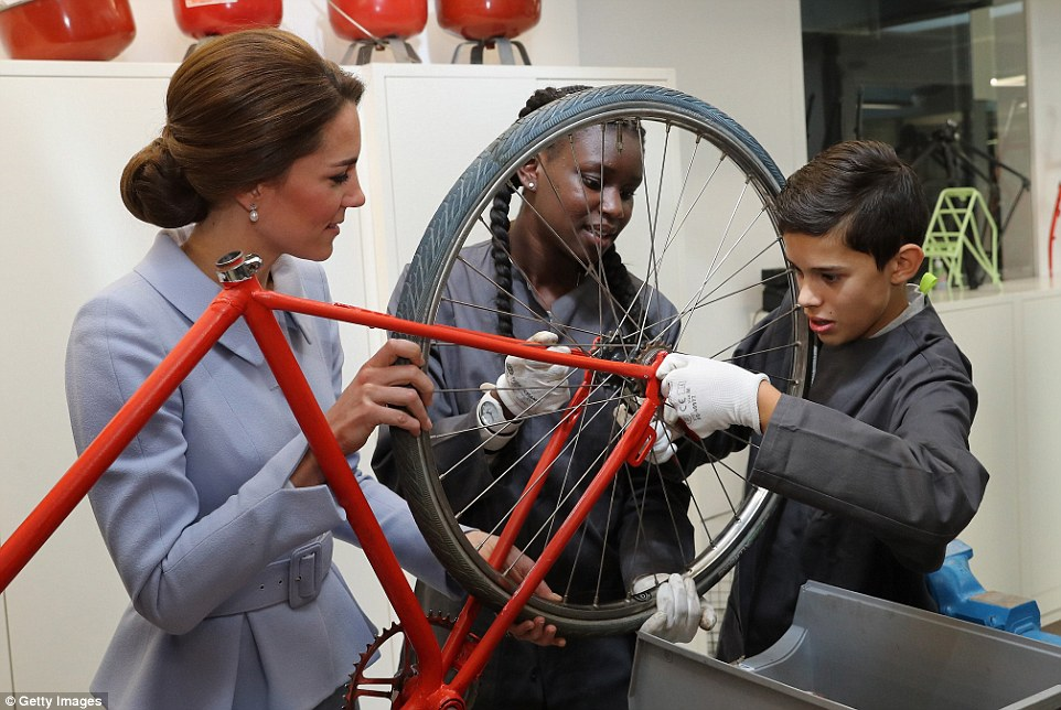 The teens were keen to show Kate the ropes as they demonstrated how to put together pieces on a bike wheel