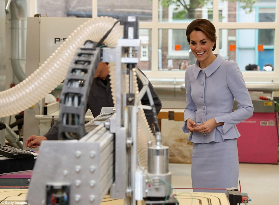 The Duchess looks delighted as she learns about woodworking at a class at Bouwkeet workshop, her final engagement
