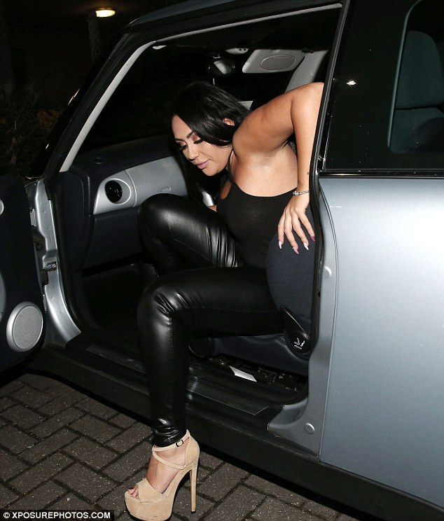 Good to go: Letting her black locks flow over her shoulders, the star completed her party-ready outfit with some nude platform heels and and large handbag