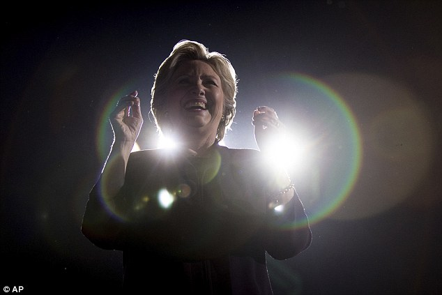 Hillary Clinton, pictured campaigning in Ohio yesterday, had no interest in addressing her email scandal at a CGI event with her husband and comedian Larry Wilmore