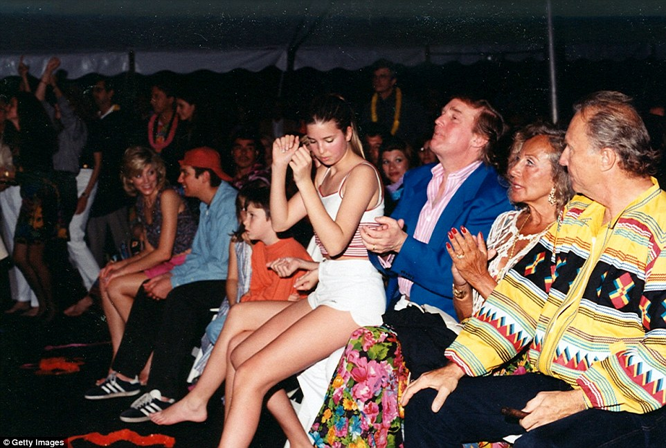Trump said that his daughter is 'an amazing beauty.' Above Ivanka sits on her father's lap in 1996 during a concert