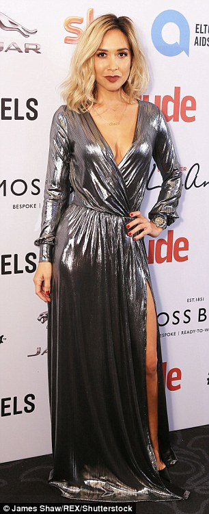 Sizzling: Myleene Klass opted for a self-designed metallic gown which featured a deeply plunging neckline alongside a sexy thigh slash