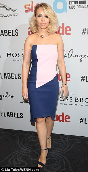 Star-studded: Katie Piper looked classy and fabulous in a strapless midi dress of blue and pink panels