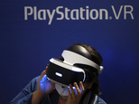 FILE - In this Sept. 15, 2016, file photo, a visitor tries out a Sony's PlayStation VR headgear device at the Tokyo Game Show in Makuhari, near Tokyo. Unlike the Oculus Rift and HTC Vive, PlayStation VR works in unison with a PlayStation 4 console instead of a high-end PC. It's also cheaper, more comfortable and will be the most convenient option for VR seekers when it's released Oct. 13. (AP Photo/Eugene Hoshiko, File)