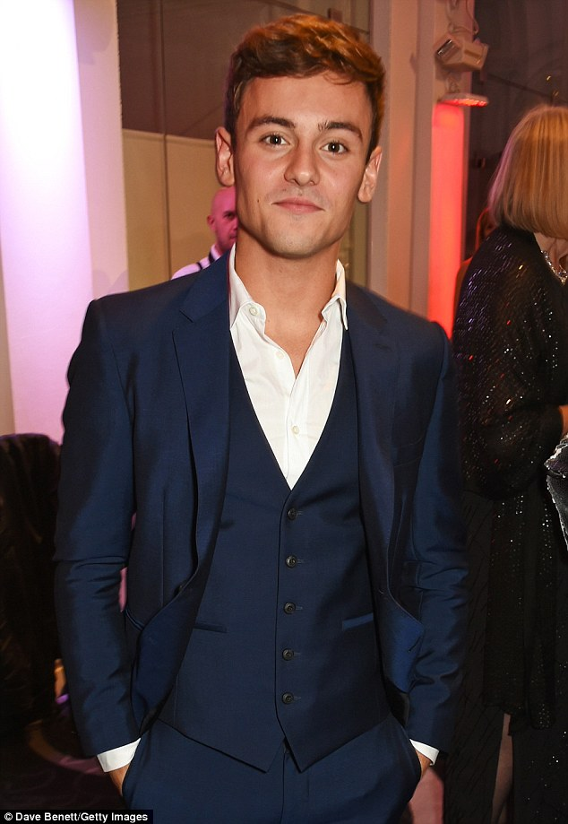Proud: Tom Daley cut an incredibly suave figure in a three-piece suit, clearly happy to attend the event after coming out as gay three years ago