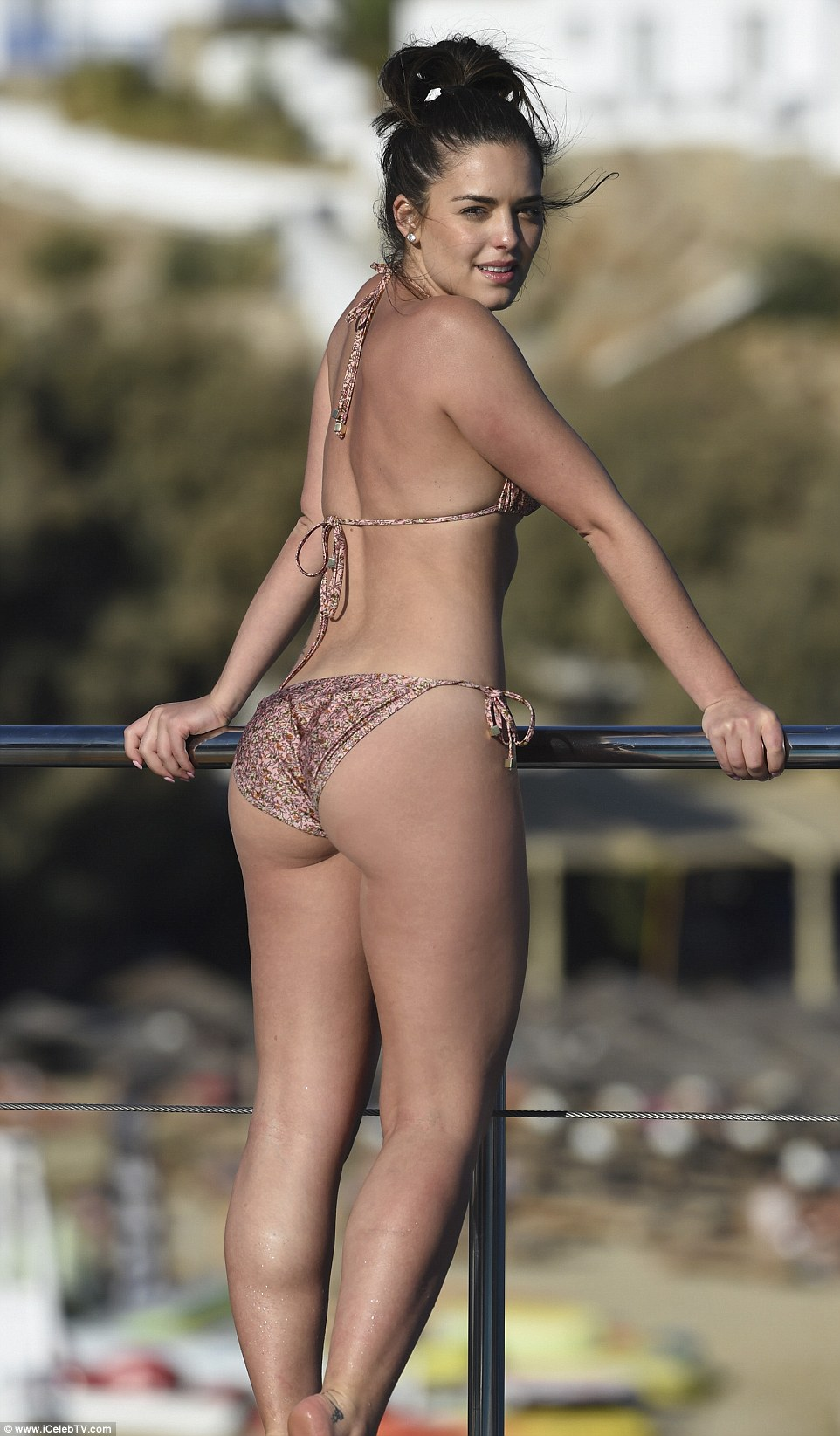 Perky! The 23-year-old stunner, who plays Paige Smith in the Australian soap, slipped into a barely-there bikini which showed off every inch of her curves as she enjoyed a poolside suntanning session