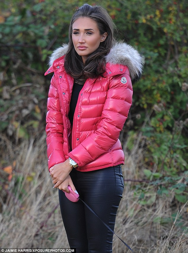 Chilled: Wrapping up for the increasingly-autumnal weather, the brunette beauty sported a fitted padded jacket in bubblegum pink